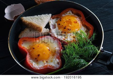 Fried eggs fried eggs in a frying pan pepper dill and spices.