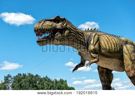 LEDMANE, LATVIA - JUNE 2017: Dinosaur sculpture in AB Park nature park in Latvia