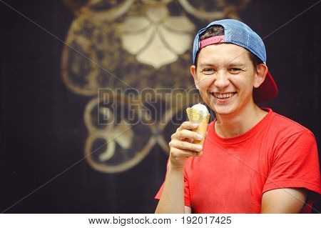 Young Man With Ice Cream Laughs