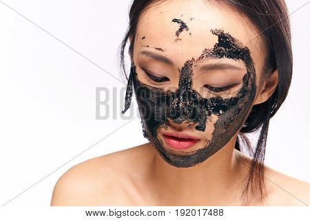 Facial treatment, skin problem, woman takes off cosmetic mask, woman on isolated background portrait.