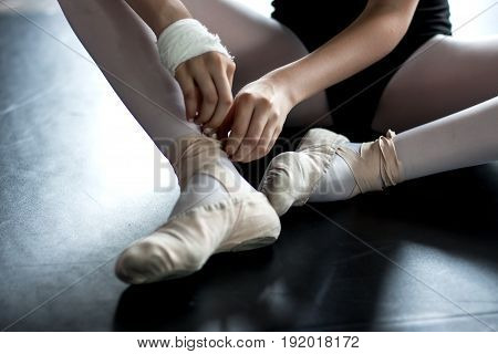 Young Ballerina Wearing Ballet Slippers