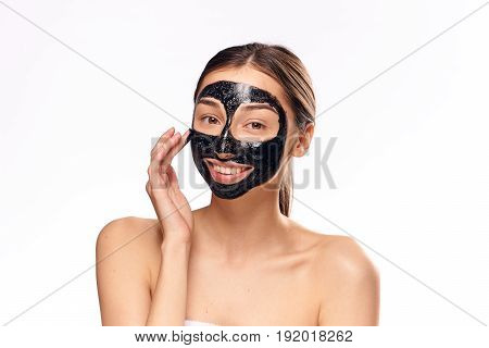 Face care, skin problem, woman in cosmetic mask, woman on light background.