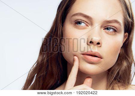 Woman thoughtful, woman on light background portrait.