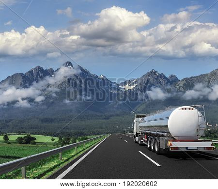 Truck on the highway on the backgrounds of beautiful mountains.