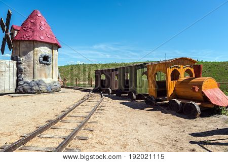 Abandoned old models of wooden train and windmill