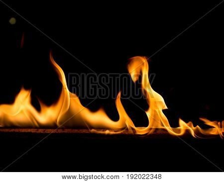 Strip of fire on a black background .