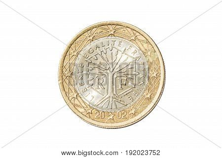 French coin of one euro closeup with tree symbol with the motto Liberte Egalite Fraternite of France. Isolated on white studio background.