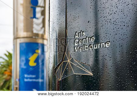 Arts Centre Melbourne Sign With Tourist Information On The Background