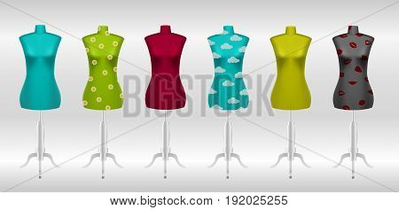 Big set of different female tailors dummy mannequins on white background