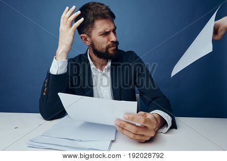 Businessman surprised, businessman working in the office, businessman with documents.