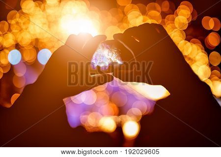 Hands with a smartphone records live music festival, Taking photo of concert stage, live concert, music festival, happy youth, luxury party