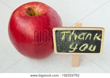 Apple With A Thank You Inscription On A Wooden Board Black Background