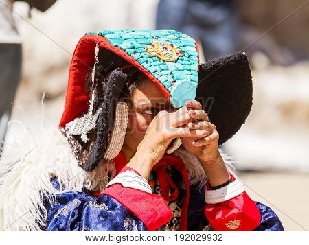 Ladakhi Tribal Woman In Traditional Clothing With Headgear