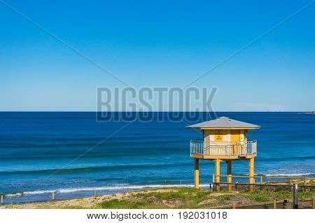 Rescue Tower On The Beach With Blue Ocean View