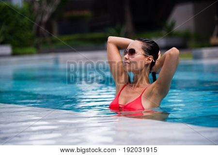 Beautiful Woman Swimming Pool At Resort Relaxed Portrait Young Asian Girl Happy Smile Tropical Vacation.