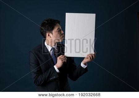 Portrait of Asian businesswoman holding whiteboard shot