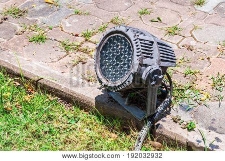 Old LED Spotlight on Concrete Brick Ground Outdoor