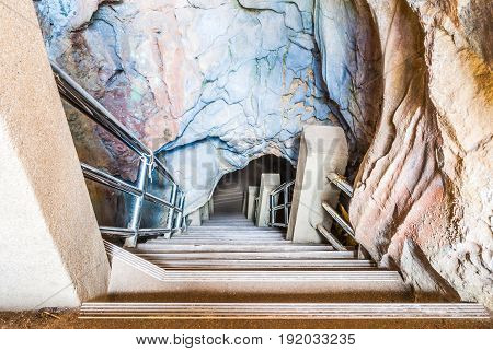 Concrete Stairway into Beautiful Natural Cave .