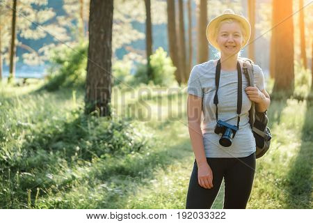 Portrait Of A Woman Travelling In The Forest With A Camera.