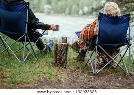 Couple Drinking Tea In The Forest.