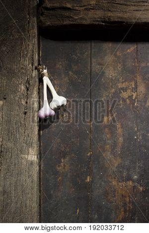 Bunch of garlic on an old wooden door