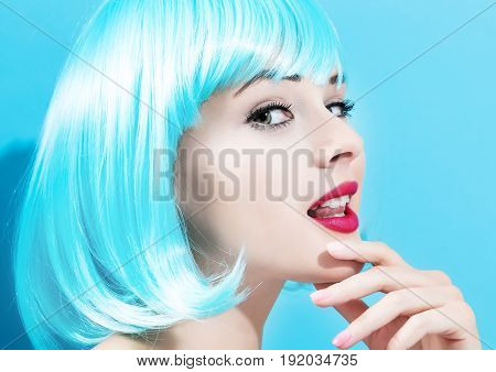 Beautiful woman in makeup with a bright blue wig
