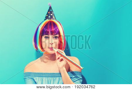 Party theme with a woman in a colorful wig