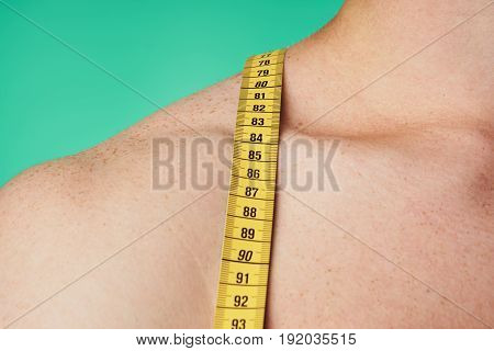 Measuring tape, man on a green background.