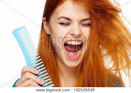 Woman with open mouth, woman with tangled hair, woman with comb on isolated background portrait.