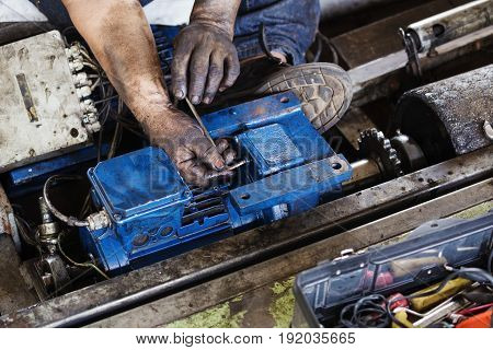 Hand Holding Hexagonal Wrench And During Maintenance Work Of Electric Motor