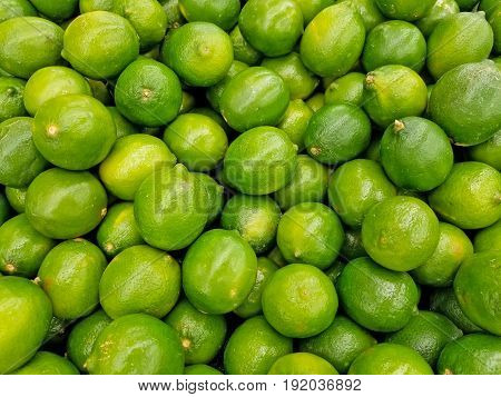 pile of whole limes at the market