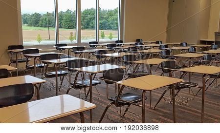 rows of vacant school desks in a high school classroom