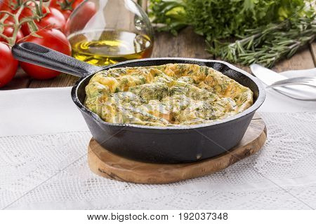 Frittata with salmon and herbs. Italian style omelets.