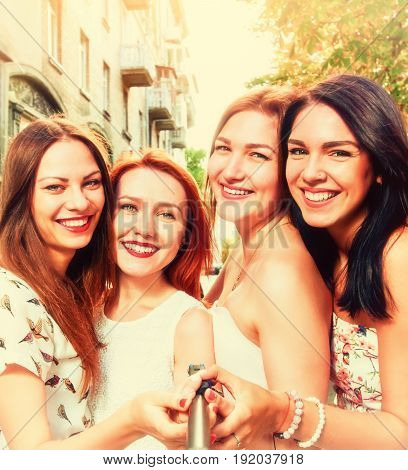 Four beautiful happy smiling women making selfie, A picture with toning and a square relation of the sides