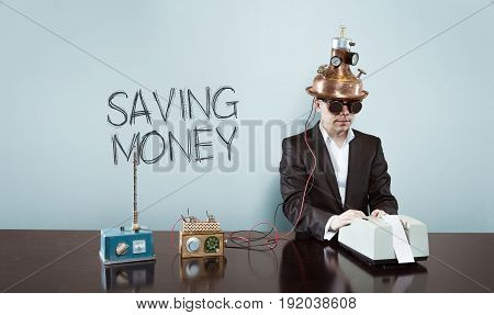 Saving money text with vintage businessman and calculator at office