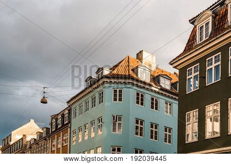 Copenhagen Denmark - August 11 2016. Low angle view of old residential buildings in historical city centre of Copenhagen a cloudy of summer near sunset