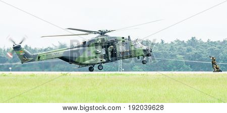 BERLIN GERMANY - JUNI 01 2016: Landing helicopter NH90 of the German Army. Exhibition ILA Berlin Air Show 2016