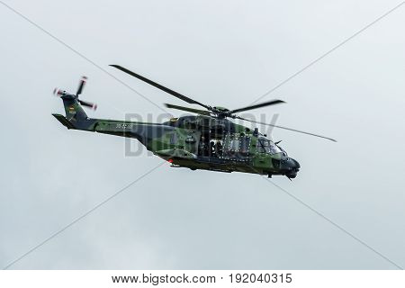 BERLIN GERMANY - JUNE 01 2016: Helicopter NH90 of the German Army. Demonstrative performance. Exhibition ILA Berlin Air Show 2016