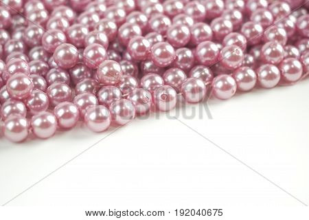 Pink bead pearl with white space on white background
