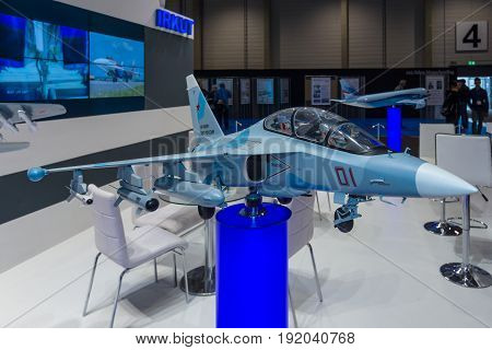 BERLIN GERMANY - JUNE 01 2016: The stand of Unated Aircraft Corporation (Russia). Model of Russian subsonic two-seat advanced jet trainer Yakovlev Yak-130. Exhibition ILA Berlin Air Show 2016
