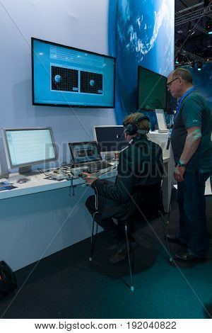 BERLIN GERMANY - JUNE 01 2016: The stand of German Aerospace Center (DLR). The simulator remote control technology. Exhibition ILA Berlin Air Show 2016.