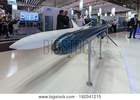 BERLIN GERMANY - JUNE 01 2016: The stand of Diehl Defence. Models of rockets Advanced Anti-Radiation Guided Missile (AARGM) and Interactive Defence and Attack System for Submarines (IDAS). Exhibition ILA Berlin Air Show 2016.