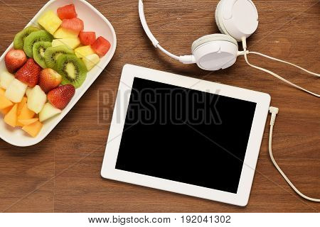 Fruit Platter And Tablet On A Wooden Tablet