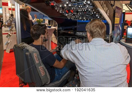BERLIN GERMANY - JUNE 01 2016: The stand of Aviare consult GmbH. Flight Simulator airliner Boeing 737-800. Exhibition ILA Berlin Air Show 2016.