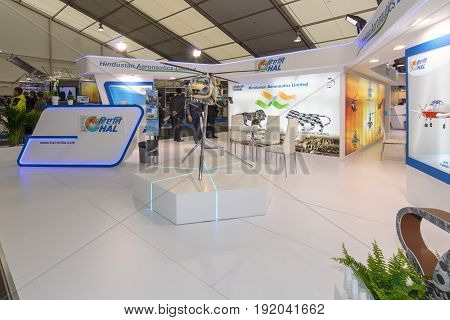 BERLIN GERMANY - JUNE 01 2016: The stand of Hindustan Aeronautics Ltd. Model of utility helicopter HAL Dhruv. Exhibition ILA Berlin Air Show 2016.