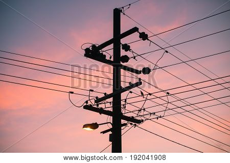 The silhouette of the electric pole with beautiful sunset.