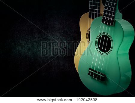 Part of an acoustic guitar on a black background.