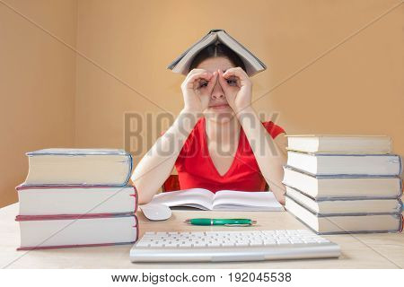Thoughts education creativity concept. Girl hiding behind the book staring at you