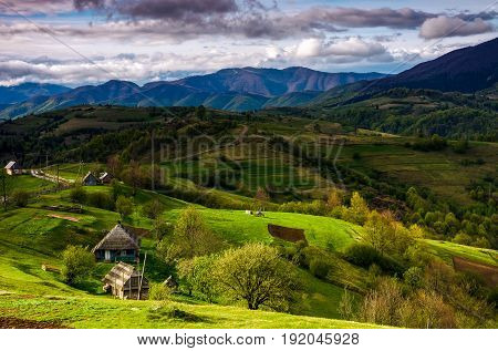 Village On Hills In Dramatic Mountain Landscape