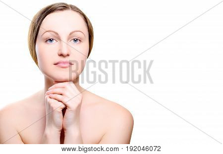 Portrait of girl with nude make-up with hands on chin isolated on white background free space for text. Girl with clean healthy skin on white copy space. Beauty model isolated on white